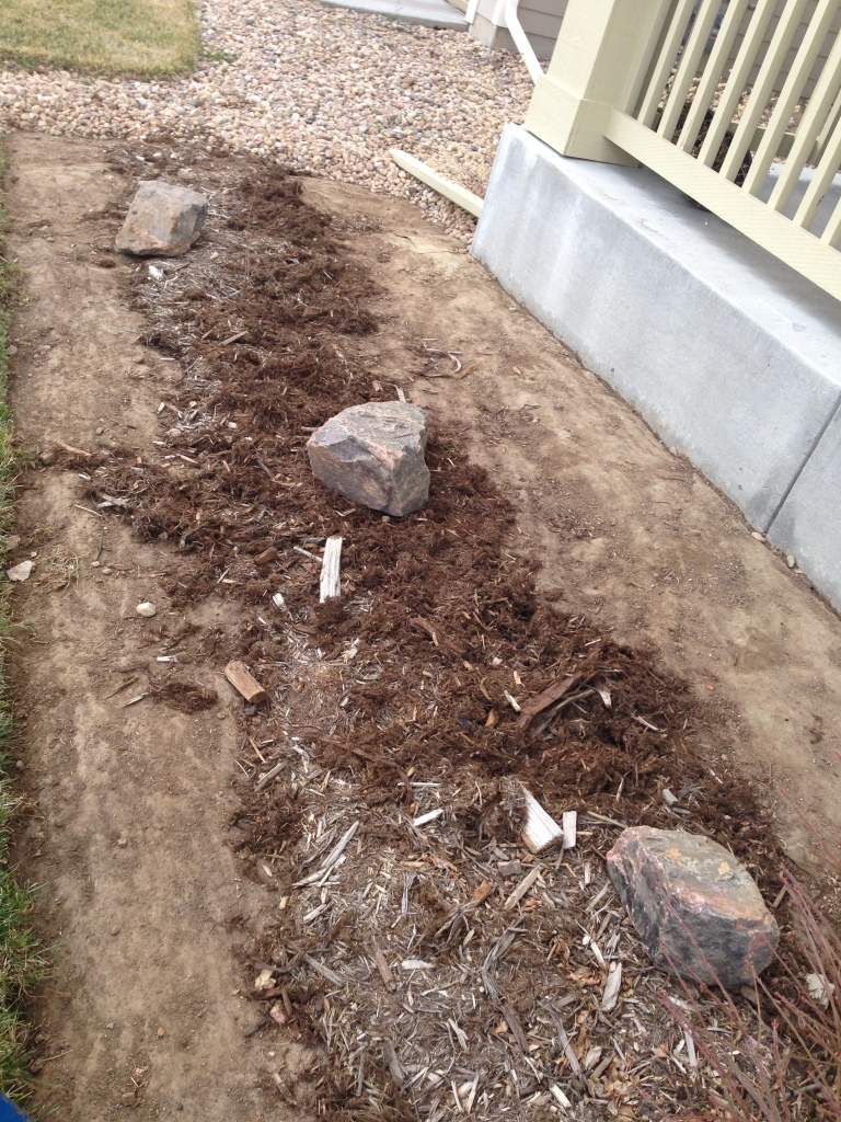 Rocks are gone, we'll add more mulch as we get things planted