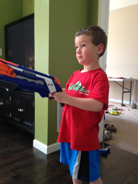"Leighton attempting to use the ""big"" Nerf gun"