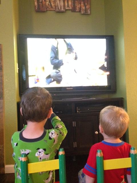 Leighton and Caedmon watching the video of Edric