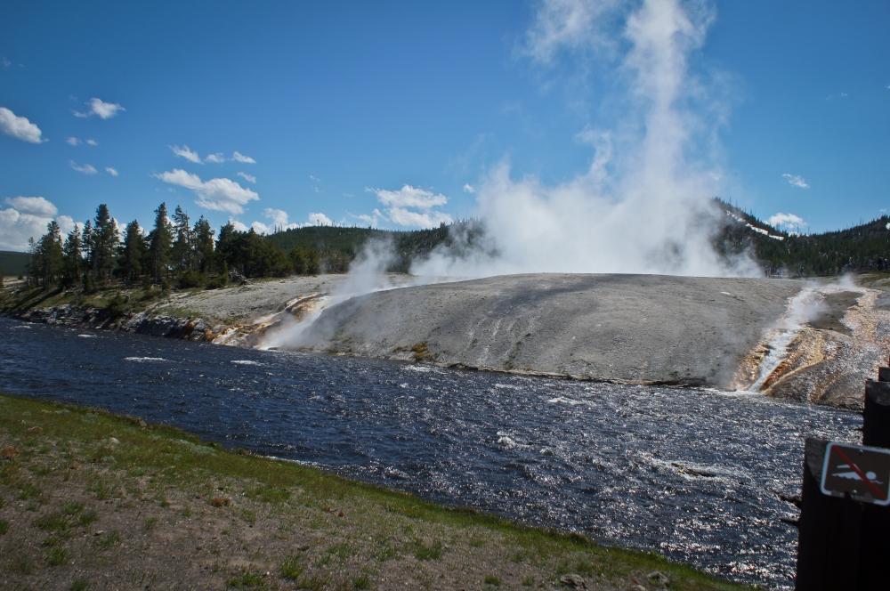 Excelsior Geyser spilling into Firehole River