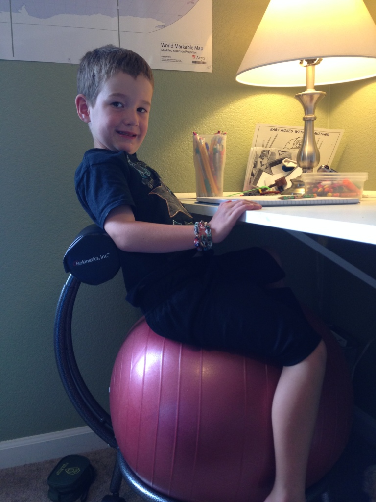 Leighton being silly on his chair
