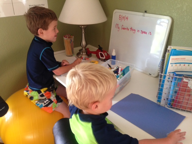 "Both boys working on their ""journal"""