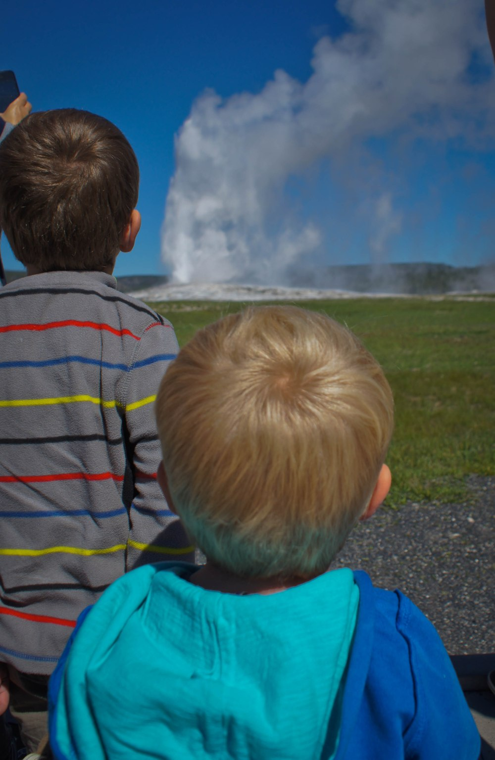 Boys watching Old Faithful