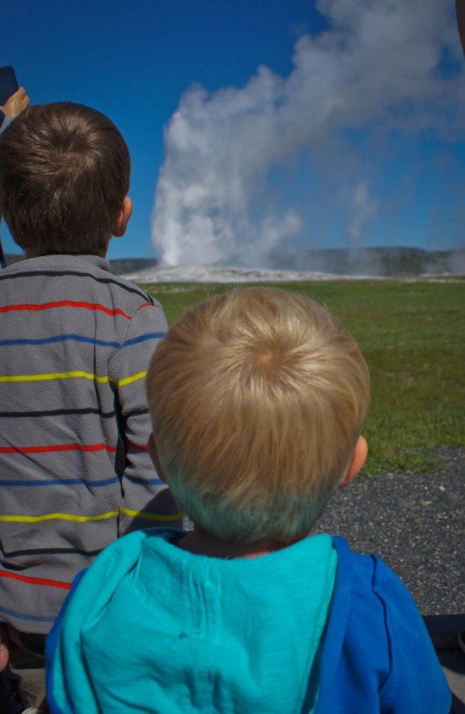 Boys watching Old Faithful