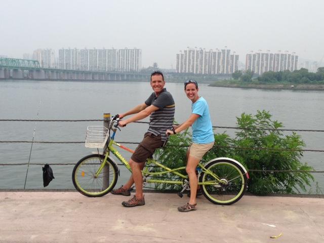 On a tandem bike!