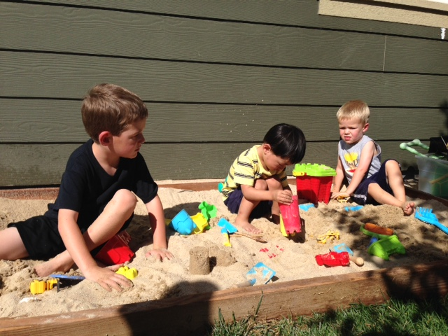 3 boys in the sandbox