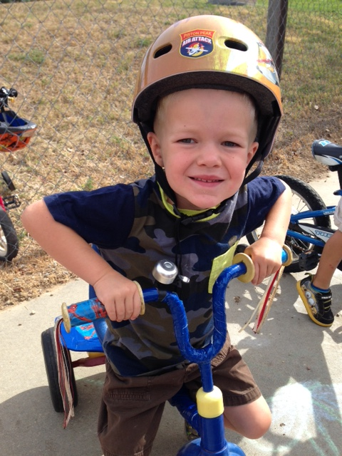Caedmon at his Bike-A-Thon, sometimes you just need a Caedmon-smile