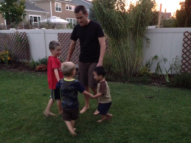 The boys playing Ring-around-the-Rosie while the sun was setting last night