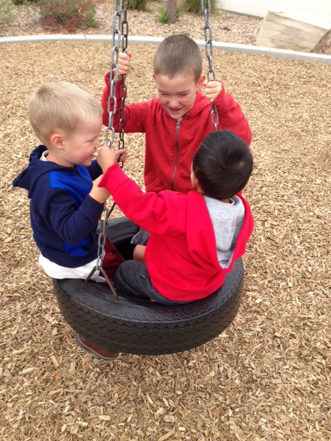 playing on the tire swing