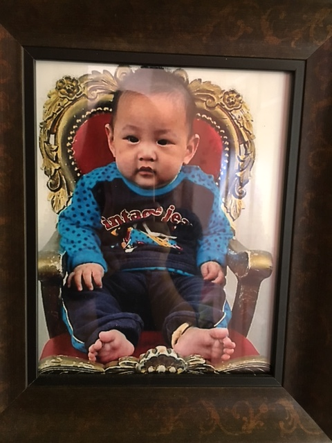 First photo of Edric in the traditional golden throne chair that all adopted little ones get taken