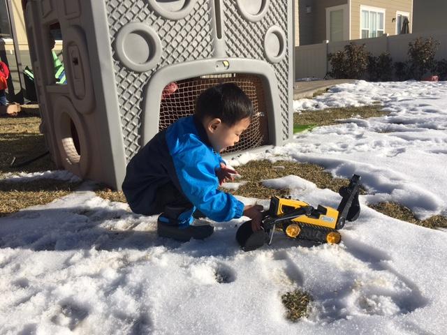 A boy and his tractors/trucks