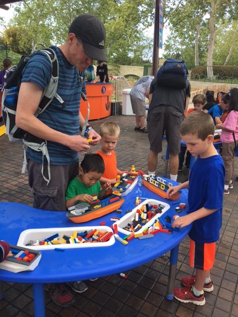 Everyone building a Lego boat